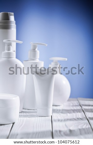 skincare composition on a blue background and white table - stock photo