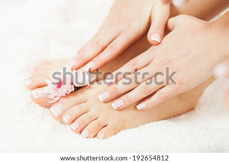 Skincare of a beauty female feet and hands - stock photo