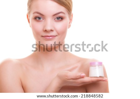 Skincare. Young woman beautiful girl taking care of her dry complexion applying moisturizing cream isolated. Beauty treatment. - stock photo