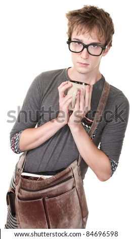 Skinny nerd with messenger bag and mug over white background - stock photo