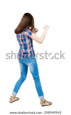 skinny woman funny fights waving his arms and legs. Isolated over white background. A young girl in a checkered blue with red stripes stands in boxing pose. - stock photo