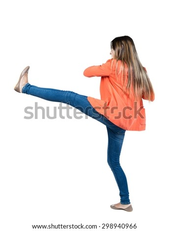 skinny woman funny fights waving his arms and legs. Isolated over white background. Girl in a red jacket raises his right leg high. - stock photo