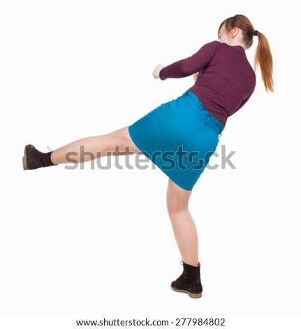 skinny woman funny fights waving his arms and legs. Rear view people collection.  backside view of person.  Isolated over white background. Angry woman in a fight. - stock photo