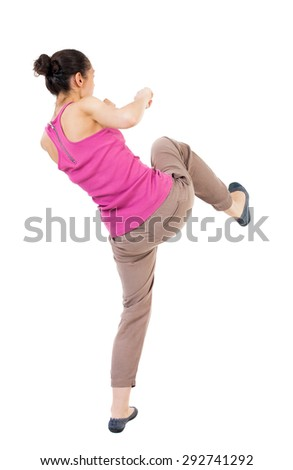 skinny woman funny fights waving his arms and legs. Rear view people collection.  backside view of person.  Isolated over white background. African-American is preparing his right foot. - stock photo