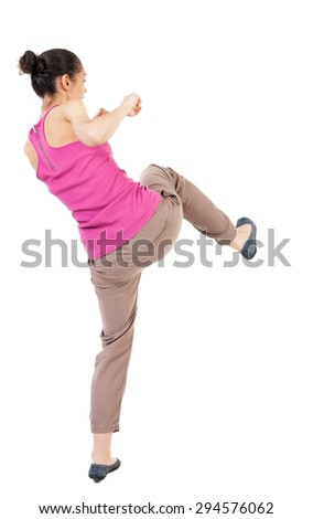 skinny woman funny fights waving his arms and legs. Rear view people collection.  backside view of person.  Isolated over white background. African-American kneaded lifting his feet. - stock photo