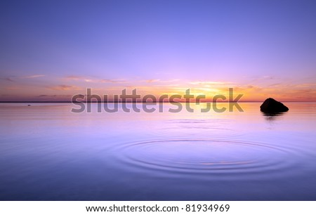 Skipping rocks, last light of a summers day - stock photo