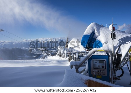 SKIWELT, AUSTRIA - January 26, 2015: Snow machine in use at the ski piste  on 26 of January, Westendorf, Austria