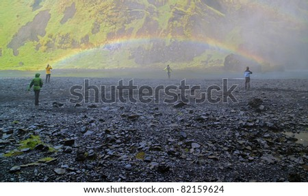 Skogafoss waterfall and rainbow in Iceland - stock photo