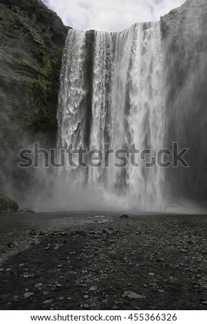 Skogafoss waterfall in southern Iceland, a very popular tourist attraction and photography stopover - stock photo