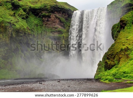 Skogarfoss waterfall. Summer seson. Iceland. - stock photo