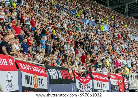 Skopje, FYROM - August 8,2017: Manchester United fans celebrating for their team during the match UEFA Super Cup final soccer between Real Madrid vs Manchester United