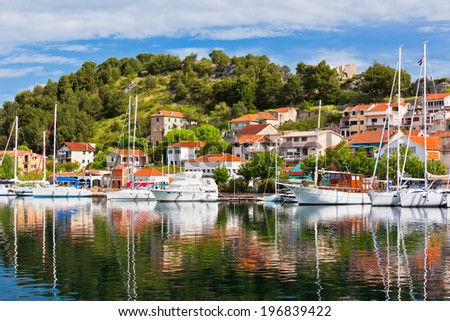 Skradin is a small historic town and harbour on the Adriatic coast and Krka river in Croatia - stock photo