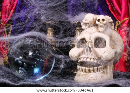 Skull and Crystal Ball with Cob Webs - stock photo