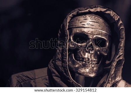 skull and hood in halloween (dark & split tone) - stock photo