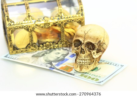 Skull and money  - stock photo