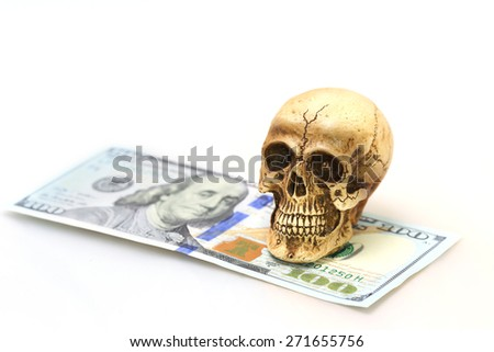 Skull and money on white background - stock photo
