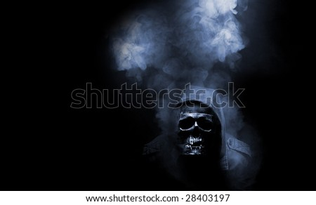 skull in hood in abstract smoke - stock photo
