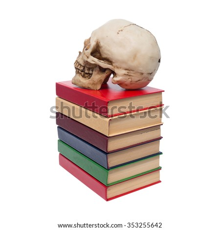 Skull of  person and  book.Isolated on white background.