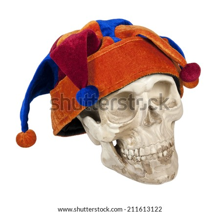 Skull wearing joker cap of many different colors - path included - stock photo