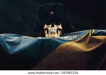 Skull with russian Ushanka on the ukraine Flag - stock photo