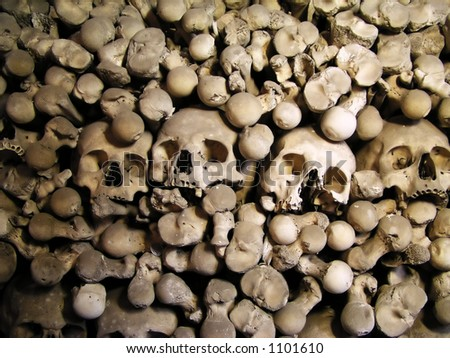 Skulls and bones from charnel-house - stock photo