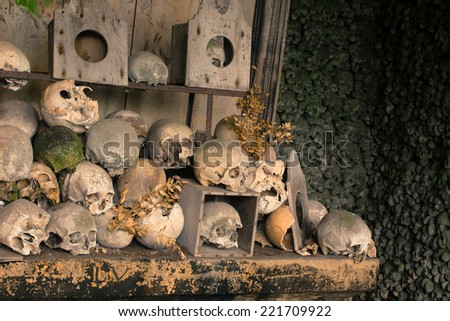 Skulls and bones inside the ossuary of Marville, France, with thousands of ancient skulls of 19th century and older - stock photo