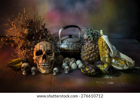 Skulls with fruit and flower rot, Still life  - stock photo