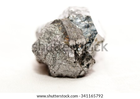 skutterudite metal ore mineral sample stock photo on a white background