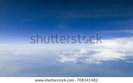 Sky and cloud as seen through window of an aircraft