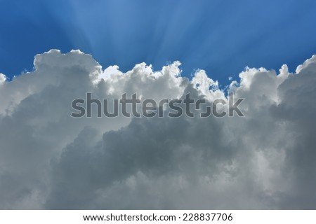 Sky and cloud. Cloud with a luminous edge and rays of the sun. - stock photo