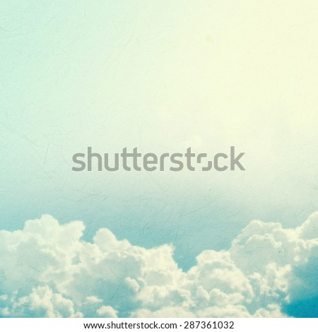 sky and clouds in vintage color style on mulberry paper texture for background