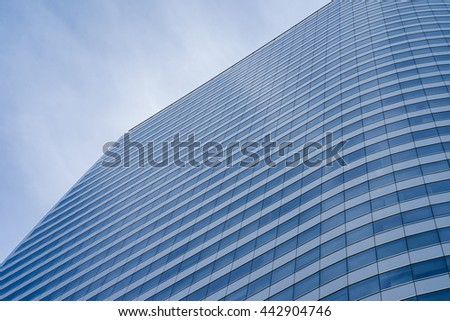 sky and clouds reflecting on a building with mirrored glass