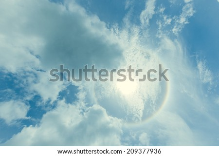 sky and clouds with sun halo phenomenon  - stock photo