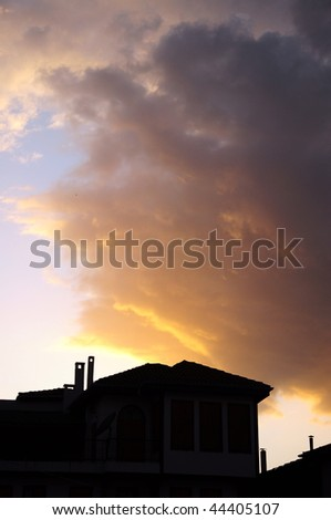 sky and house during sunset - stock photo