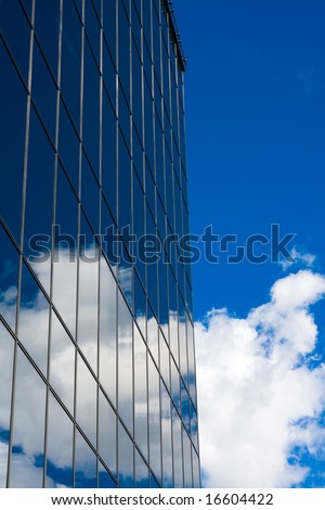 Sky and office building of glass - stock photo