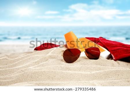 sky and suntan oil  - stock photo