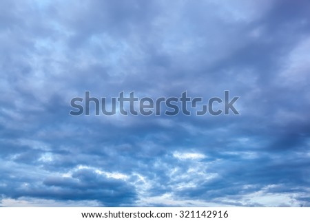 Sky at sunset with thunderclouds. - stock photo