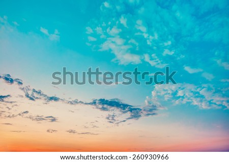 Sky Background, Bright Blue, Orange And Yellow Colors Sunset. Instant Photo, Toned Filtered Image - stock photo