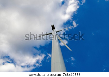 Sky background patterned blurred with wind turbines.