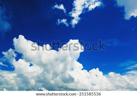 Sky background with the fluffy white clouds, natural background - stock photo