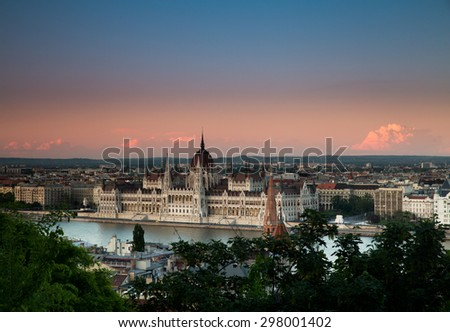 Sky Blue Pink Sunset Over the Danube and Budapest Parliament - stock photo