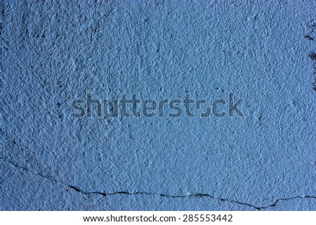 Sky blue walls are textured black dirt stains. - stock photo