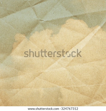 Sky clouds on a textured, vintage paper background  - stock photo