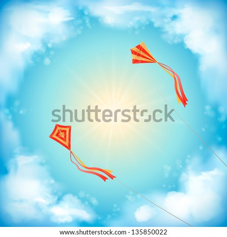 Sky design with white fluffy clouds, sun, blur, red flying kites on a clear summer day. Artistic background with space for text at the backdrop in blue and yellow pastel colors