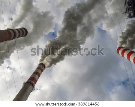 Sky engages covered < cover > and from high chimneys smoke (smoke) leaving (go out) - stock photo