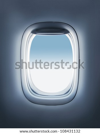 sky in the airplane porthole - stock photo