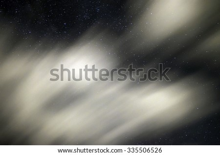 Sky in the night with stars and clouds blurry because they are in long exposure in summertime - stock photo