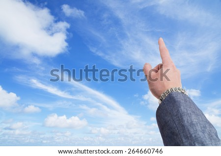 Sky is the limit concept with hand in business suit  pointing toward the sky - stock photo