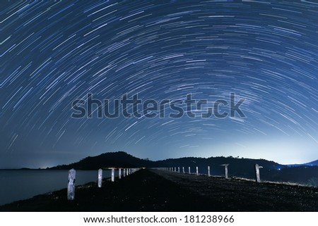 Sky of stars in lake, rotated, night - stock photo
