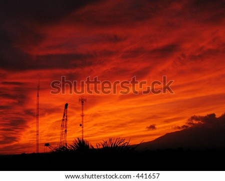 sky on fire (antennas and mechanical towers seen in lower left)